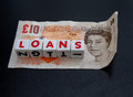 Small loans a ten pound note with text in red uppercase text on white cubes dark background Stock Photo