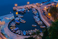 Small marina by night in ulcinj montenegro Stock Image