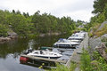 Small marina in a norwegian fiord near larvik norway Stock Photo