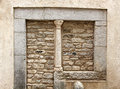 Small medieval column, in a stone wall Royalty Free Stock Photo