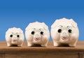 Small medium and large piggy banks on shelf Royalty Free Stock Photo