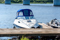 A small motor blue boat and pier Royalty Free Stock Photo