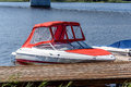 A small motor red boat and pier Royalty Free Stock Photo