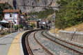 Small mountain railway station surrounded by mountains Royalty Free Stock Photos