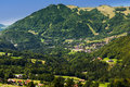 Small mountain village in haute savoie france onnion vilage sky tracks visible on hills Royalty Free Stock Photos