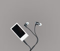 Small MP3 music player and earbuds Royalty Free Stock Photo