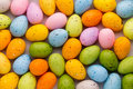 Small multicolored Easter eggs. Spring background.