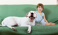 Small nice girl on couch with dog dogo argentino focus Stock Image