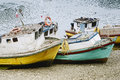 Small old fishing boats on the beach at puerto montt chile Stock Images