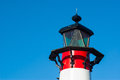 Small old red and white lighthouse by the sea Stock Photo
