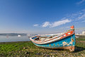 Small, old traditional boat in Seixal bay Royalty Free Stock Photo