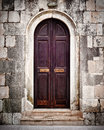 Small old wooden church door Royalty Free Stock Photo