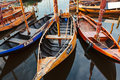 Small old wooden fishing boats in the netherlands dutch city elburg Stock Photo