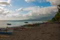 A small outrigger style Banca boat rests on a tropical beach.Pandan, Panay, Philippines. Royalty Free Stock Photo