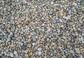 Small pebble rocks background texture on the floor rocky stone Stock Images