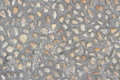 Small pebbles embedded in the ground texture Stock Photo