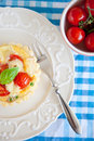 Small pie with brie and tomatoes Royalty Free Stock Photo