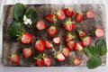 Small pieces of strawberries for the preparation salad Royalty Free Stock Photos
