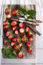 Small pieces of strawberries for the preparation salad Royalty Free Stock Image