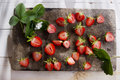 Small pieces of strawberries for the preparation salad Stock Photography
