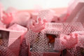 Small pink crowns decorate a box christening favors Royalty Free Stock Photography