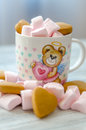 Small pink marshmallow with biscuits in the cup Royalty Free Stock Photo