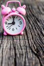 Small pink watch on wood. Royalty Free Stock Image