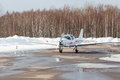 Small plane at the airport in winter Royalty Free Stock Photo