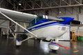 Small plane in hangar a cessna aircraft parked a Royalty Free Stock Photos