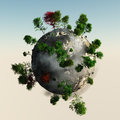 Small planet with trees rocky Royalty Free Stock Image
