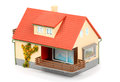 Small plastic house red roof white background Royalty Free Stock Images