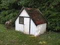 Small play house in a lovely green garden Stock Images