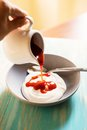 Small porcelain pitcher with rose hip jam Royalty Free Stock Photo