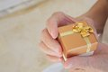 A small present in the hands of senior woman Royalty Free Stock Photo