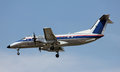 A small prop plane coming in for landing Royalty Free Stock Photo