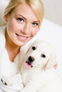 Small puppy sitting on the hands of woman pretty Royalty Free Stock Photo