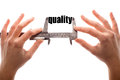 Small quality color horizontal shot of two hands holding a caliper and measuring the word Royalty Free Stock Photos