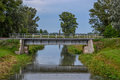 Small railroad bridge over water chanell Royalty Free Stock Photo