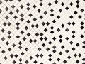 Small random black and white small ceramic tiles background, on diagonal. Royalty Free Stock Photo