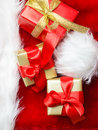 Small red and golden boxes with gifts tied bows Royalty Free Stock Photo