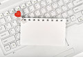 Small red hearts and sticky note on laptop keyboard Stock Photography