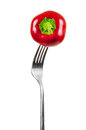 Small red pepper on a fork Royalty Free Stock Photo