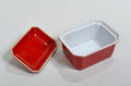 Small red porcelain bowl set on a white surface Stock Photo