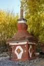 Small red tibetan stupa in Lupra village Royalty Free Stock Photo