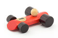 Small red wooden toy racing car on white Stock Photo