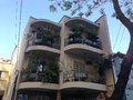 Small residential building with rounded balconies and many plants são paulo brazil Stock Photos