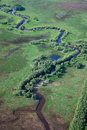 Small river on the green plain aerial view in summer Stock Photos