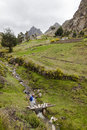 Small river and hillside farms near zumbahua creek that runs through where tourists stroll around province of cotopaxi ecuador Stock Photo