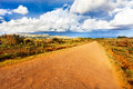 Small road in easter island on sunny day Royalty Free Stock Photography
