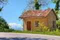 Small rural brick house near road trees piedmont northern italy Royalty Free Stock Photos